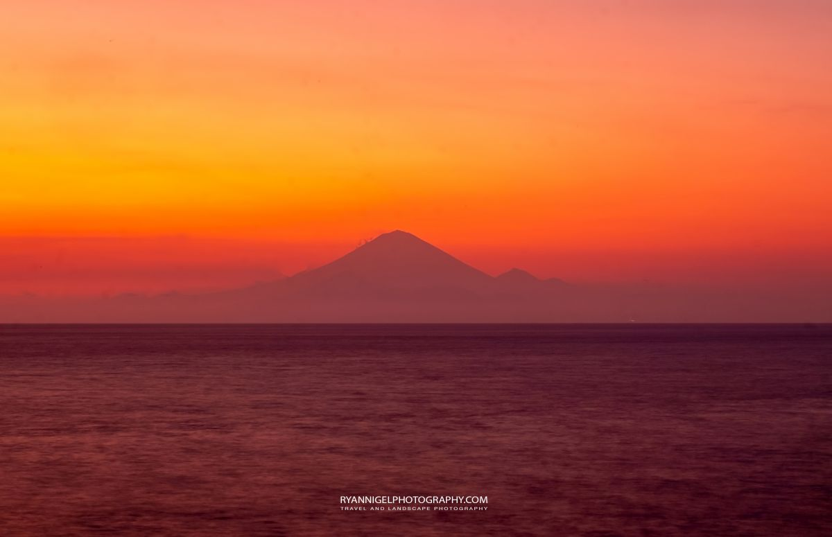 Sunset seen from Karandangan Viewpoint with Mount Agung (Bali) in the background